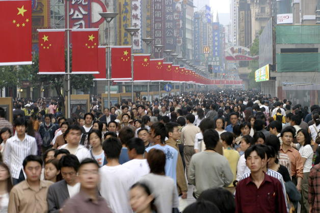 Crowds line the centeral shopping district of Nanjing Road on May Day Weekend in Shanghai