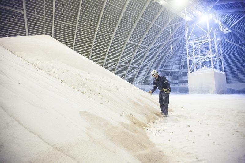 Chris McKay, PotashCorp load-out supervisor at the Cory Mine, examines potash inside one of the storage facilities near Saskatoon